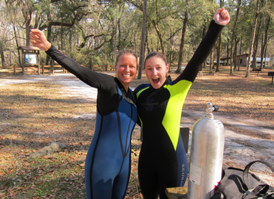 Tallahassee SCUBA Instructor Gabrielle with student Erin celebrate her successful checkout dives to earn her open water certification!